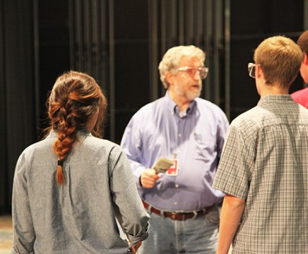 Theatre teacher Bill Ballard gives the students instructions on how to paint parts of the sets for the Coppell theatre production The Drowsy Chaperone. Photo by Rinu Daniel.