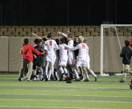 The Coppell Cowboys Soccer team celebrates after winning the 5A State Championship in overtime. Photo by Susie Shahsavari