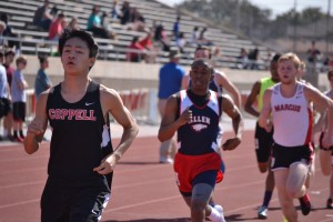 Freshman Alan Huo runs the 800-meter dash at Coppell relays on March 1.
