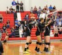 Seniors Kylie Pickrell, Laura Hogan and Cathryn Cheek stand ready for a return at the net. Photo by Chelsea Banks.