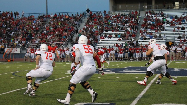 Senior Conner Williams (55) and Glenn Williams (75) block upfield during Friday nights game. Photo by Stephanie Alexander.