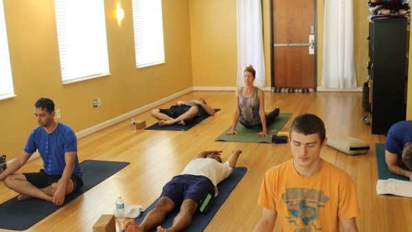 Yoga class attendees breathe and stretch before morning class on Oct. 25. Photo by Stephanie Alexander.