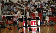 Sophmore Katie Herklotz and seniors Laura Hogan and Kylie Pickrell await a serve during their game against Southlake Carroll last night.