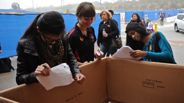 Student Council member Taylor Stiff helps record the turkeys donated at Coppell High School's 19th annual Turkey Drive. The drive was hosted Nov. 21; families could donate online or in person. Photo by Sarah VanderPol.