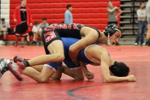 Cowboys dominate in Santa Slam duals, Cowgirls show some improvement