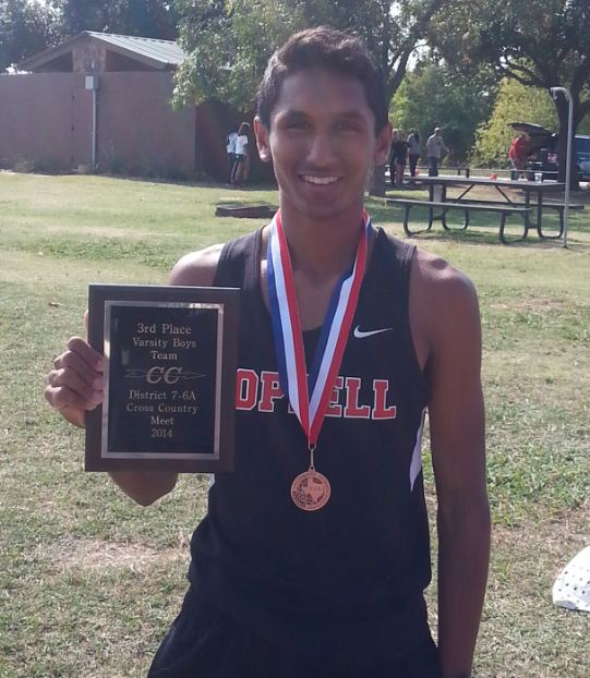 Senior Josh Thomas hold up his team's third place ranking at the district cross country meet on Oct. 23 Thomas was able to help lead his team to get a ranking high enough to qualify them for regionals last fall.
