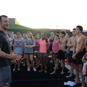 Coppell High School cross country coach Nick Benton instructs the team after running a time trial early Saturday morning at Buddy Echols Field. The varsity team is preparing for a meet on Saturday in Round Rock. The junior varsity team is attending the Jesuit Invitational. Photo by Jennifer Su.
