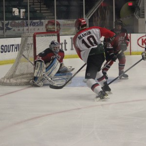 Junior forward James Reaman shoots the puck at the opposing goal in a playoff game against Frisco on Mar. 3, 2015. Coppell lost 1-0, eliminating them from the playoffs. Photo by Kelly Monaghan.