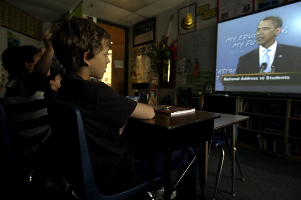 Alex Burckle, 10, center, listens to President Barack Obama's back-to-school speech in his fifth grade class that Georgia Nelson teaches at the Hough Street School in Barrington, Illinois, on Tuesday, September 8, 2009. (Lane Christiansen/Chicago Tribune/MCT)