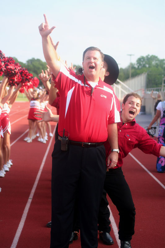 Principal Brad Hunt and senior Jake McCready cheer at the Aug. 28 pep rally.