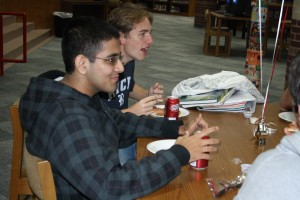 Seniors Bharad Raghavan and Henry Trahan enjoy pizza and salad at the luncheon