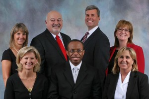 Amy Dungan (front row, far right) poses with fellow school board members.