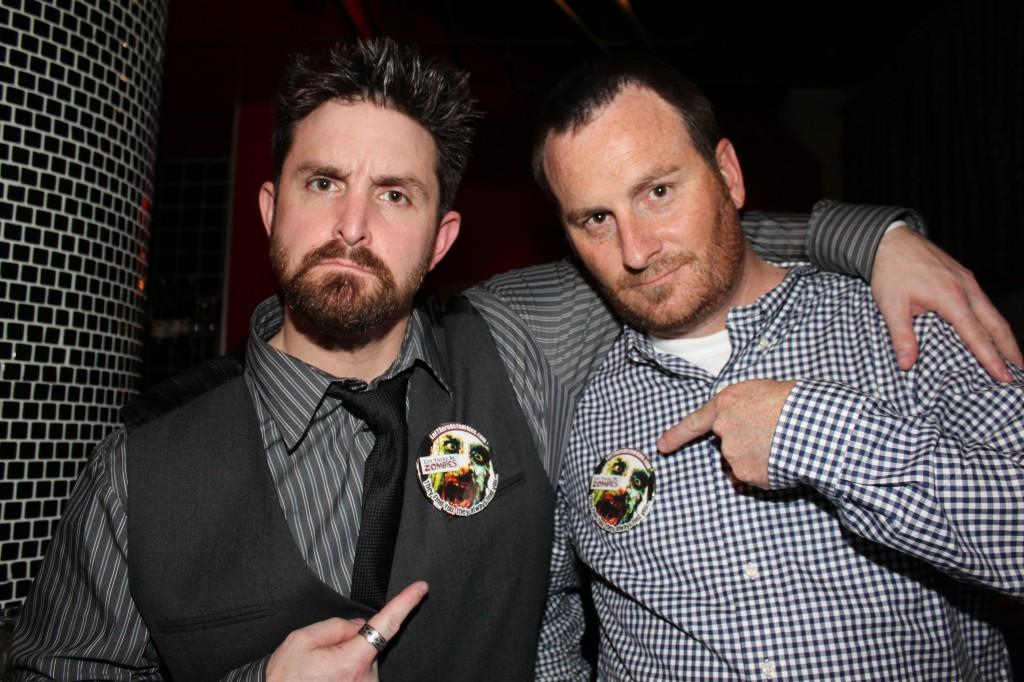 Patterson (left) and Bowden (right) show off their Let There Be Zombies fundraiser buttons. Photo courtesy of Andrew Patterson