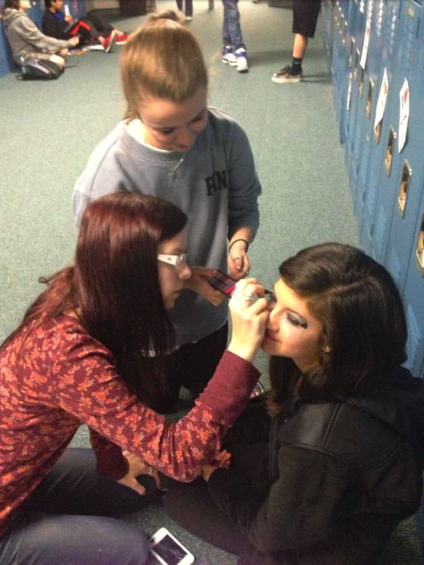 "Coppell Middle School West eighth grade media students Gracie Webb and Lindsay Hopkins do Isy Martinez's makeup for her role as ""The Screech"" in their short film. Photo courtesy of Monica Champagne."
