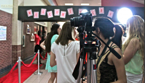 Photographers and reporters prepare for filmmakers and sponsors to walk the red carpet at the CHS Film Festival on Monday evening. Photo by Regan Sullivan.