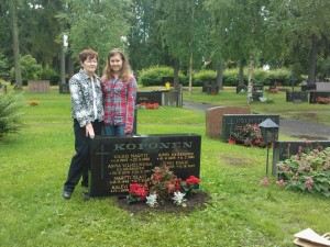 My grandmother and I posing for a picture at my grandfather's grave site in  Oulu, Finland after cleaning it up and planting flowers there during my and my mother's trip to Finland in July 2012.