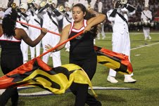 Junior Anna Garza performs a color guard routine with the band during halftime at the football game against McKinney Boyd on Friday, September 6. Coppell beat Boyd, 49-24. Photo by Regan Sullivan.
