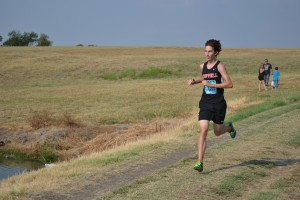 Senior Justin Armenta leads the JV boys at the Prosper Invitational, earning the team a first place finish overall. Photo by Elizabeth Sims.