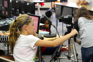 Fifth grade students at Cottonwood Creek prepare to film their daily announcements. The EMAC Academy was able to help them improve their show. Photo by Alyssa Frost.