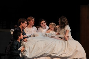 In The Sound of Music, Scene 7: Maria and The Von Trapp Children together in the Governess bedroom as Maria tries to calm the children from the fierce thunderstorm. Photo by Mark Slette.