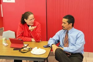 Michelle Kellen, current associate principal at Coppell High School, talks to Principal Mike Jasso during B lunch about upcoming events. Kellen is leaving Coppell High School at the semester. Photo by Nicole Messer.