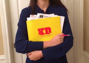 Senior Caroline Carter holds up just one of the many SAT study materials students would have used for the Dec 7 test.