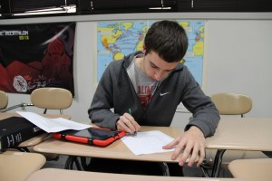 Senior Blake Simon studies for the upcoming Academic Decathlon state competition in San Antonio, which begins on Feb. 21. Photo by Sandy Iyer
