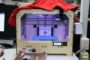 The engineering department received this MakerBot Replicator 1 3D printer from its booster club last year. Students use this printer for both projects and engineering competitions. Photo by Sandy Iyer.