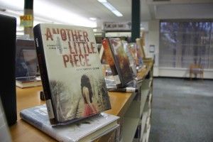 """The Between the Lines reading program was started three years ago in an effort to increase reading among teens as well as to help foster a love of reading in teens through books such as """"Another Little Piece"""" by Kate Karyus Quinn. Photo by Sandy Iyer."""