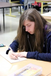 On Tuesday, freshman Kristin Boyer works on a portrait piece of her sister in Elsa Reynolds Art class. Boyer was chosen as one of the State Youth Art Month winners by the Texas Art Education Association. Photo by Alyssa Frost.