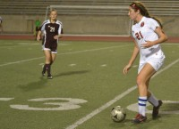 Junior forward, Sarah King, carefully drives the ball down field, before taking a shot on goal. King scored the only goal of the game for the Cowgirls. Coppell defeated Plano, 1 to 0. Photo by Julia Olson.