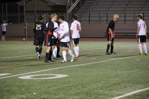 Coppell junior midfielder Drew Brinda positions himself to defend a corner kick from the Marcus Marauders in the teams' Feb. 14 match. Coppell defeated the Marauders 2-0 in the regional final match on Saturday, Apr. 12. Photo by Shannon Wilkinson.