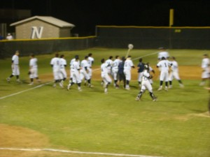 Nimitz celebrates its 5-2 victory over Coppell on Friday, May 2