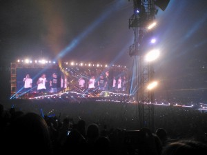 """After a short break halfway through One Direction's performance, the boy-band returned to perform the second half starting off with """"You and I"""". Zayn Malik hits the high notes in his solo as the crowd screams its appreciation for his vocal range. Photo by Tuulia Koponen"""