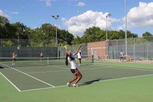 Nikita Simha prepares to serve in her doubles match on Tuesday evening.