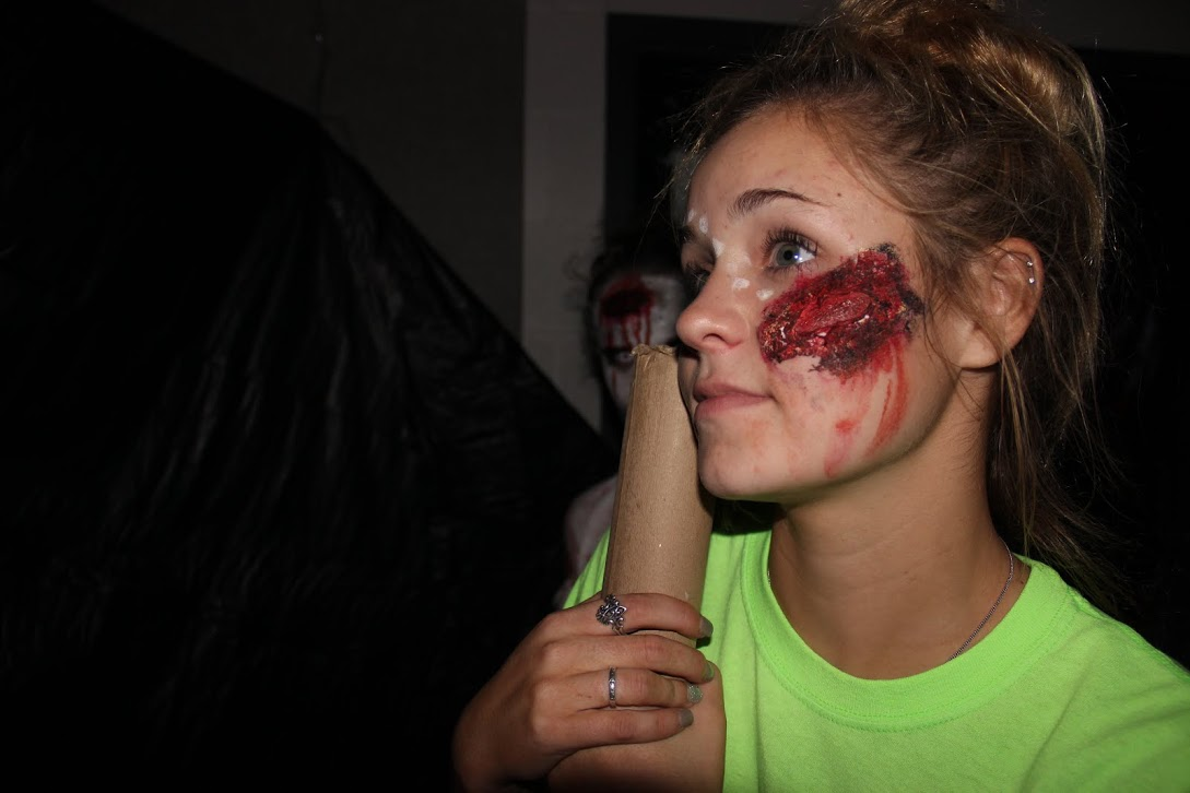 Junior Berkley Bonneau shows her terrifying face makeup off at the New Tech Haunted House on October 23. Bonneau was one of the students who signed up to participate in the haunted house.
