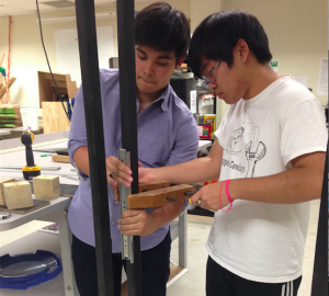 Juniors, Zane Erickson(left) and Neno Teruya(right), are working on their first mock up of the project, Gateways, Thursday in the STEM room. Photo by Gabby Sahm