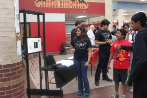 Junior Ruth Fernandes shows community members the first mock up of Gateways, an new inventions for the special needs students, at the STEM Expo. Photo by Gabby Sahm.