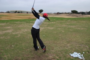 Senior Sol Lee perfects her golf swing during practice at Hackberry Creek on Dec. 3. Lee practices an hour to two hours everyday.