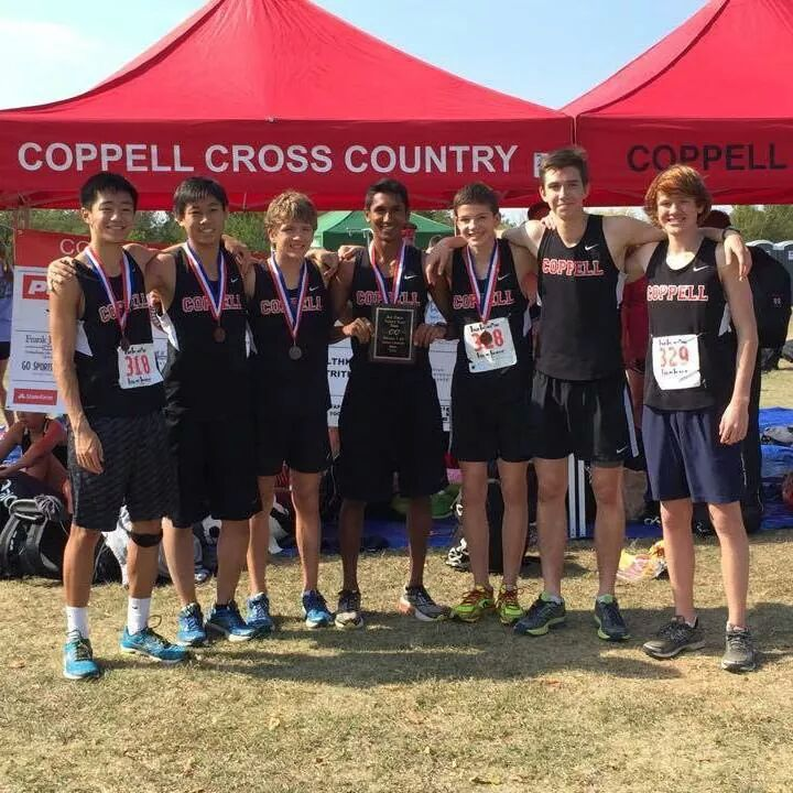 Senior Josh Thomas (center) and the varsity cross country boys team at the district meet receive third place qualify for regionals on Oct. 23.