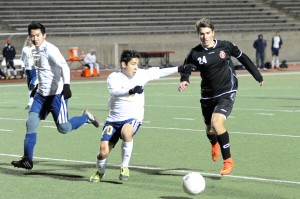 Senior Colten Clark dribbles past an El Paso Coronado in their match on Friday, Jan. 9. Coppell won the match 1-0. Photo by Sarah VanderPol