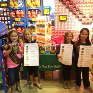 Troop 4887 Girl Scouts Audrey, Lucia, Anna and Gaby sell cookies at the local Tom Thumb Saturday afternoon. According to them Thin Mints and Samoas are the best sellers. Photo by Aubrie Sisk.