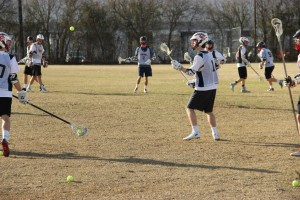 Senior Ben Dodson throws the ball during a practice on Jan. 16. Lacrosse equipment can cost over $1,000. Photo by Mallorie Munoz.