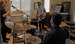 Coppell High School junior Grayson Harris, senior Christian Meyer and Trinity Christian Academy senior Taylor Goode practice multiple times  a week at Meyer's house. The band just formed and are preparing for potential live performances. Photo by Kara Hallam.