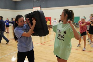 In the first gym at Coppell Middle School East, a pair of CHS seniors practice an onward attack lead by the Coppell Police Department from 6:30-8p.m. Photo by Amanda Hair.
