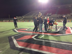 The girls track team lifts their District 7-6A championship trophy at Buddy Echols field on Tuesday night. The Cowgirls took first as the Cowboys took second place, losing only to Southlake Carroll. Photo by Shivani Burra.