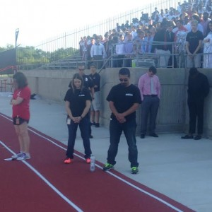 Coppelll High School principal Mike Jasso observes a moment of silence on the anniversary of 9/11 during the homecoming pep rally at Buddy Echols Stadium on Sept. 11. Photo by Mallorie Munoz.