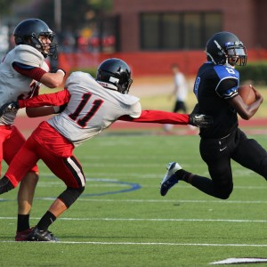 Coppell JV Black cornerback Sam Castranova attempts to tackle Hebron High School player  Aug. 27 at Buddy Echols Field. Castranova is a very versatile player and contributed in the Cowboys 7-6 win.