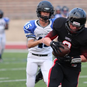 Coppell Cowboys JV Red tight end Connor Salerno runs 25 yards after a 20 yard pass to score the first Cowboy touchdown Aug. 27 at Buddy Echols Field to help the Cowboys win 27-13 over Hebron.