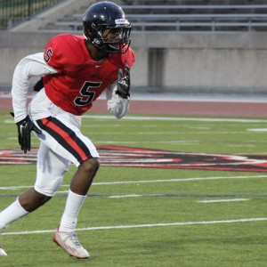 Coppell High School JV Red sophomore Kolbe Branch carries in the Cowboys' 31-0 victory over L.D. Bell on Sept. 24 at Buddy Echols Field.